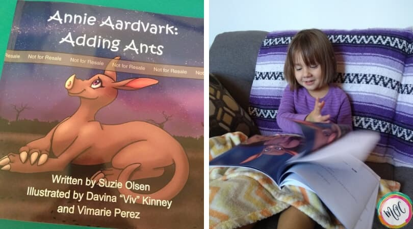 Annie Aardvark: Adding Ants book cover. Our daughter Caroline is flipping through the pages enjoying her STEM reading experience.