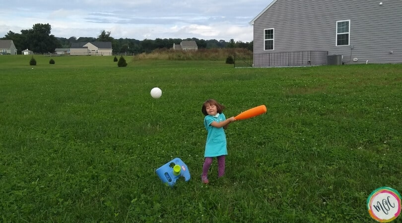 Caroline enjoying the outdoors playing t-ball