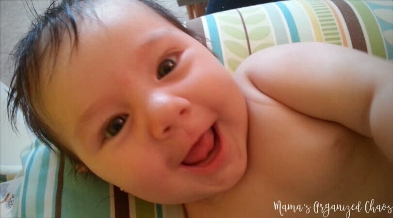Baby smiling after breastfeeding. Scheduling resources.