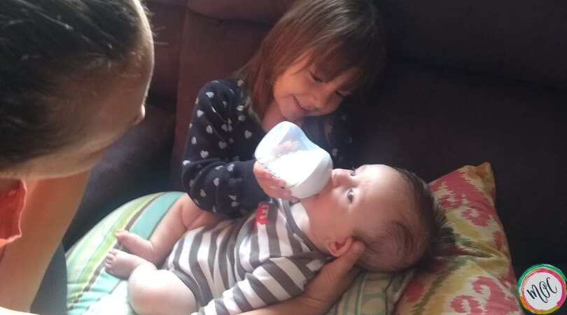 4 year old bottle feeding 4 month old