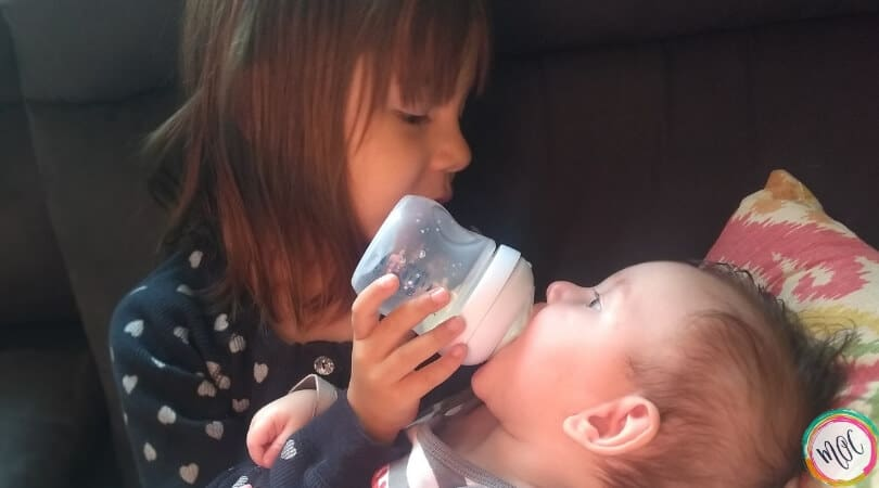 4 year old feeding 4 month old a bottle
