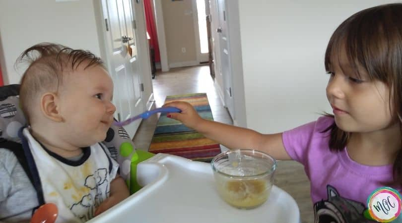 4 year old feeding 6 month old solid food