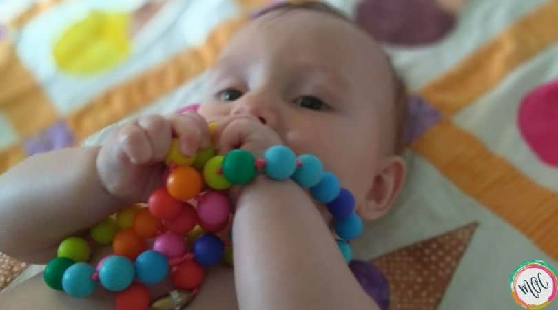 6 month old chewing on teething necklace